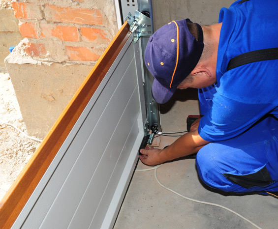 technician replacing a garage door