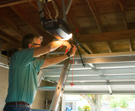 technician repairing garage door opener