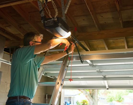 technician repairing garage door chain